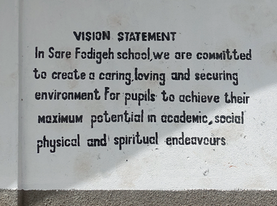 Text written on a school in The Gambia.